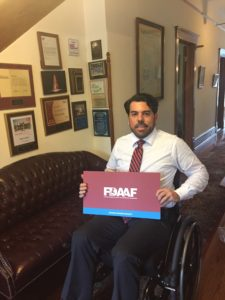 Dan Vasquez sitting in a wheelchair